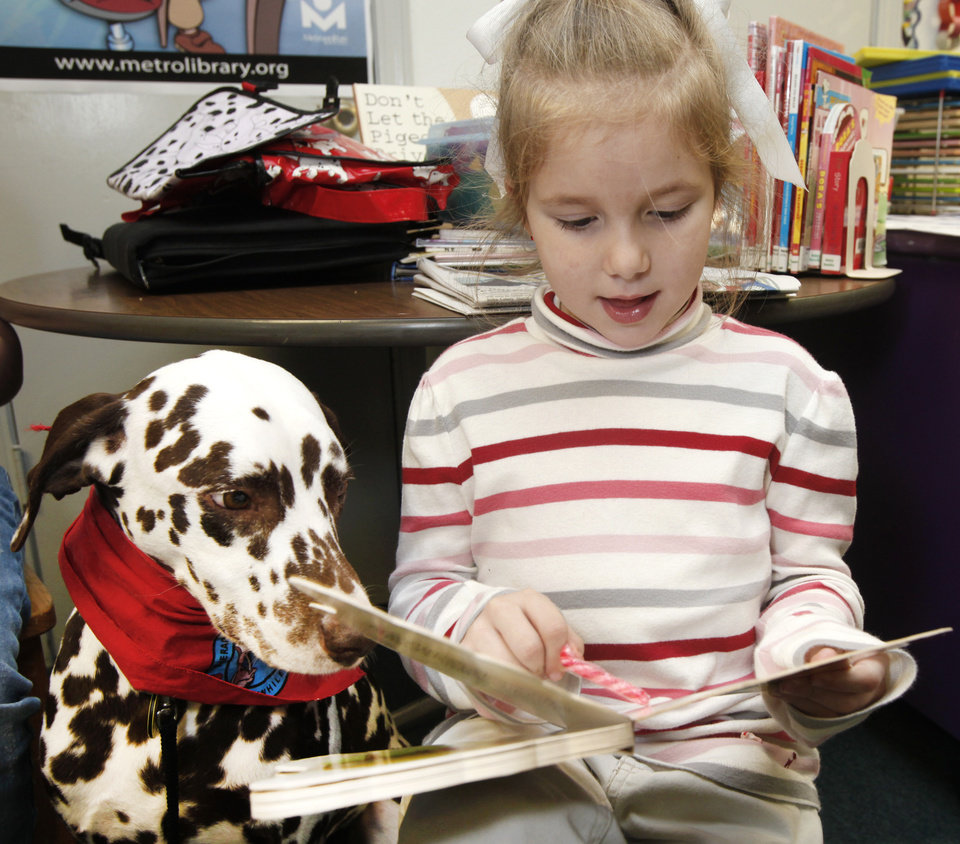 READING: Paige Fowler, 6, reads to D'Leo, a Dalmatian therapy dog, at the library in Nicoma Park, Oklahoma January 14, 2010. Photo by Steve Gooch, The Oklahoman ORG XMIT: KOD