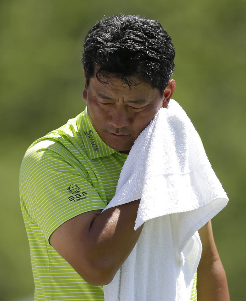 Photo - K.J. Choi, of Korea, wipes his face on the fifth tee during the second round of the Memorial golf tournament Friday, May 30, 2014, in Dublin, Ohio. (AP Photo/Darron Cummings)