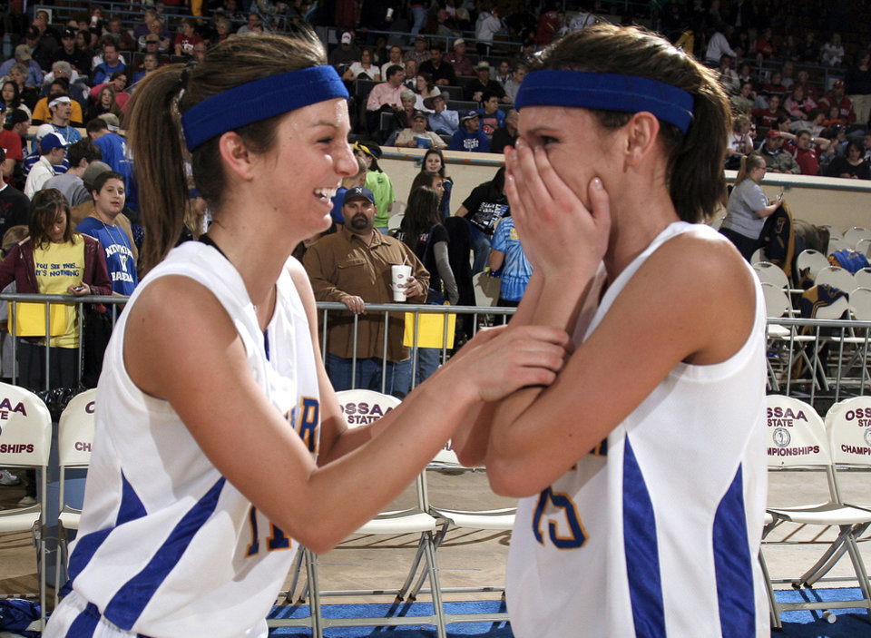 Photo - Newkirk's Hayley Luis, left, and Kaylyn Pulley celebrate their win over Howe in the girls 2A semifinal at the State Fair Arena, Friday, March 13, 2009, in Oklahoma City. PHOTO BY SARAH PHIPPS, THE OKLAHOMAN