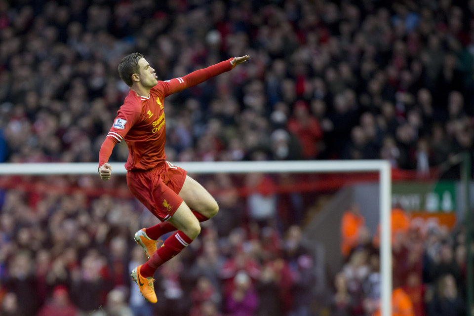 Photo - Liverpool's Jordan Henderson celebrates after scoring his first goal against Swansea City during their English Premier League soccer match at Anfield Stadium, Liverpool, England, Sunday Feb. 23, 2014. (AP Photo/Jon Super)