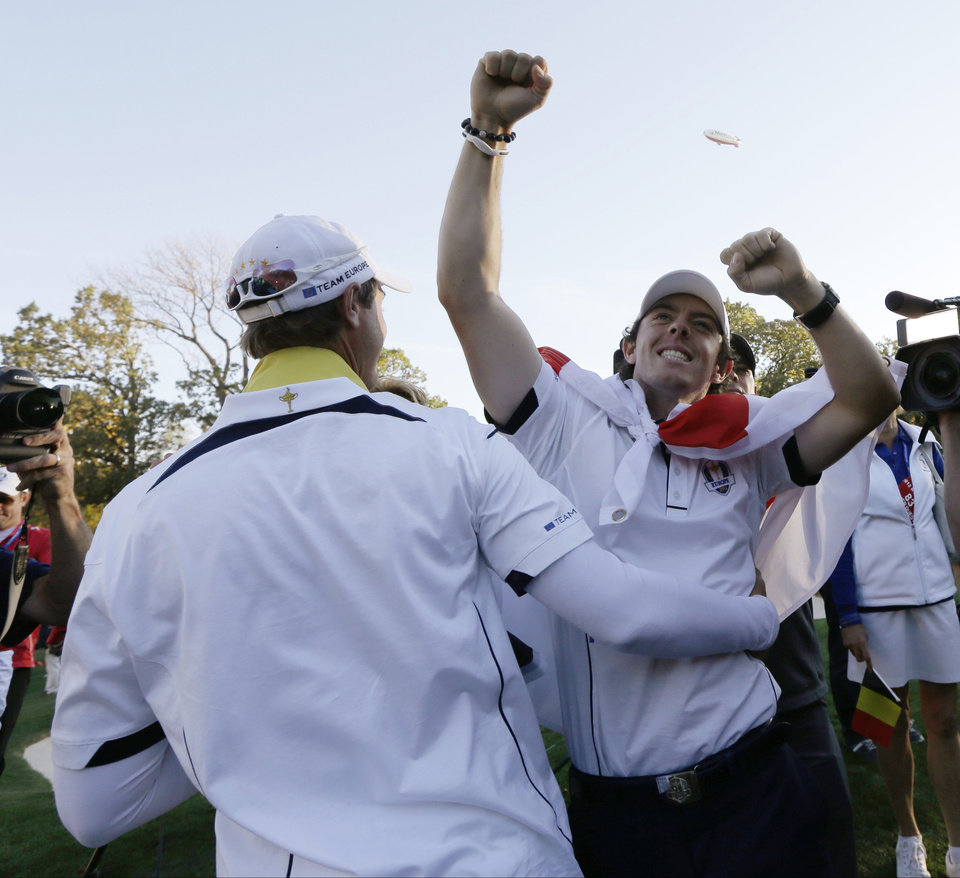 Europe's Rory McIlroy, right, and Nicolas Colsaerts celebrate after winning the Ryder Cup PGA golf tournament Sunday, Sept. 30, 2012, at the Medinah Country Club in Medinah, Ill. (AP Photo/David J. Phillip)  ORG XMIT: PGA239