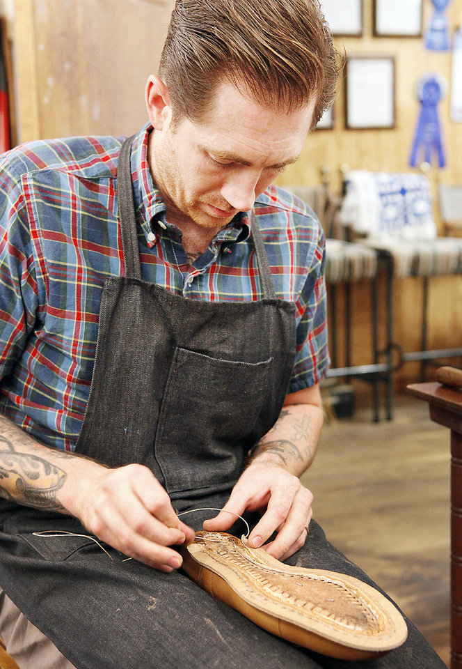 Photo - Daniel McRorie, from Brooklyn, N.Y., works Thursday on making a shoe in a class at Sorrell Custom Boots in Guthrie. Photo By David McDaniel, The Oklahoman