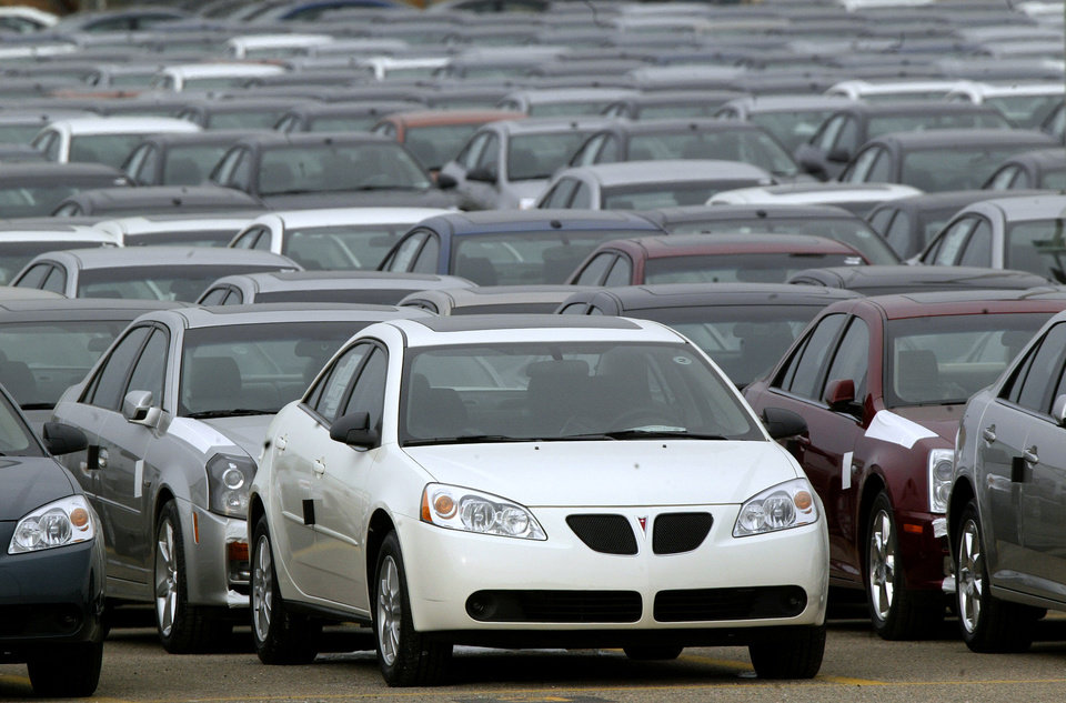 Photo - FILE - This March 16, 2006 file photo shows a Pontiac G6  shown outside the General Motors Orion Assembly plant in Orion Township, Mich. General Motors is recalling 2.4 million vehicles in the U.S., including Pontiac G6's from the 2005-2008 model years, as part of a broader effort to resolve outstanding safety issues more quickly.  (AP Photo/Paul Sancya, File)