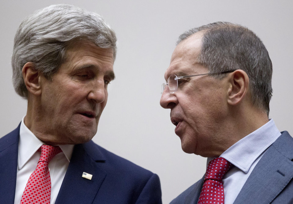 Photo - FILE - In this Nov. 24, 2013 file photo U.S. Secretary of State John Kerry, left, and Russia's Foreign Minister Sergey Lavrov, talk during a photo opportunity at the United Nations, in Geneva, Switzerland. Tehran may have a new ally on Tuesday when Iran nuclear talks reconvene _ the Ukraine crisis. U.S.-Russian tensions over Ukraine could fray the search for consensus on what Iran needs to do to ease fears it could make atomic arms. (AP Photo/Carolyn Kaster, Pool, File)