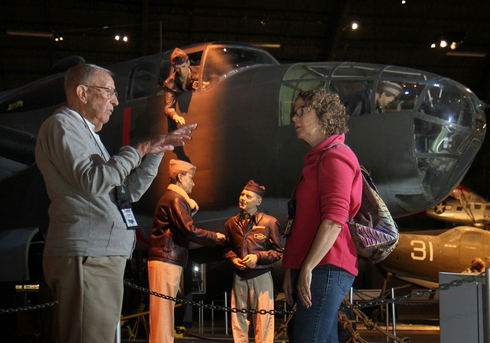 Photo - In this Sept. 27, 2013 photo former B-25 pilot Paul Young, left, talks with his daughter, Susan Frymier, during a reunion of the 57th Bomb Wing in front of a B-25 bomber in the U.S. Air Force Museum at Wright Patterson Air Force base in Dayton, Ohio. Young rarely talked about his service during World War II - about his 57 missions, about the dangers he faced or the fears he overcame.