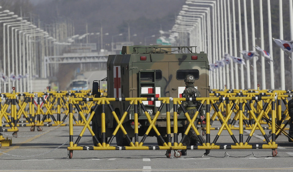 Photo - A South Korean military ambulance passes at barricaded Unification Bridge near the border village of Panmunjom, that has separated the two Koreas since the Korean War, in Paju, north of Seoul, South Korea, Tuesday, April 9, 2013. North Korean workers didn't show up for work at a jointly run factory complex with South Korea on Tuesday, a day after Pyongyang suspended operations at the last remaining major economic link between rivals locked in an increasingly hostile relationship. (AP Photo/Lee Jin-man)