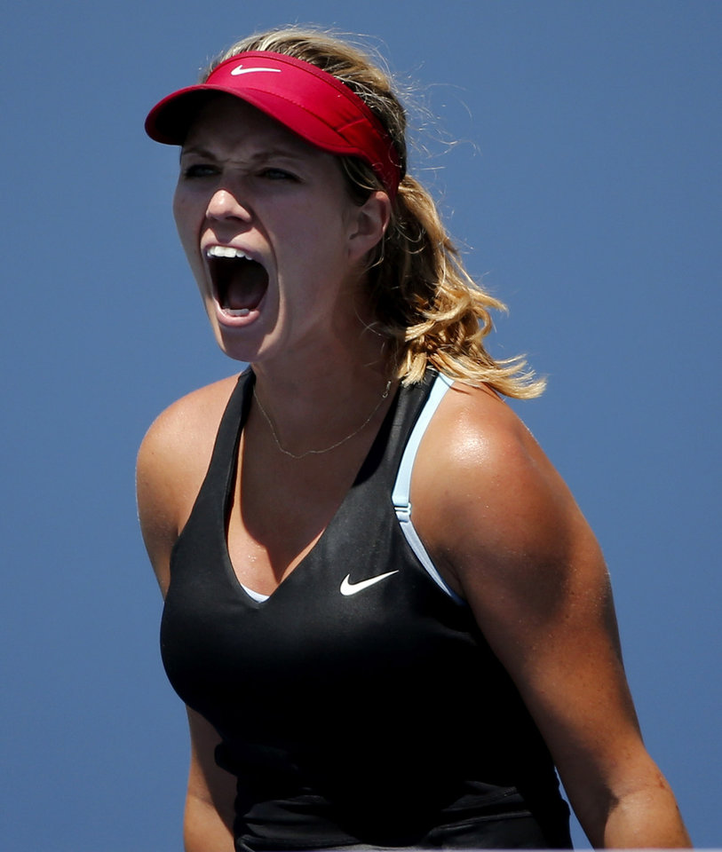 Photo - Danielle Rose Collins, of the United States, reacts after a shot against Simona Halep, of Romania, during the opening round of the 2014 U.S. Open tennis tournament, Monday, Aug. 25, 2014, in New York. (AP Photo/Elise Amendola)