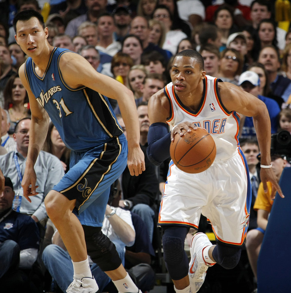 Oklahoma City's Russell Westbrook (0) leads a fast break in front of Washington's Yi Jianlian (31) during the NBA basketball game between the Washington Wizards and the Oklahoma City Thunder at the Oklahoma City Arena in Oklahoma City, Friday, January 28, 2011. Photo by Nate Billings, The Oklahoman