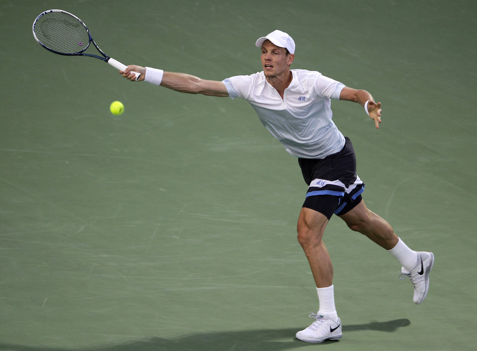 Photo - Tomas Berdych of the Czech Republic returns the ball to Philipp Kohlschreiber of Germany during a semi final match of the Dubai Duty Free Tennis Championships in Dubai, United Arab Emirates, Friday, Feb. 28, 2014. (AP Photo/Kamran Jebreili)