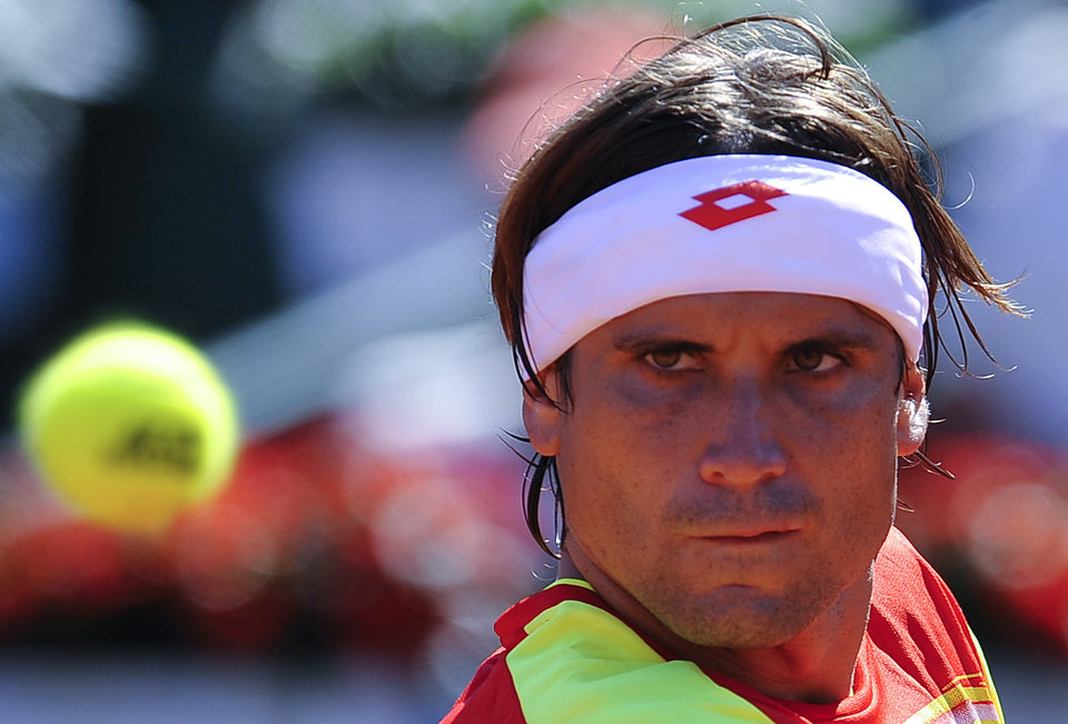 Photo -   Spain's David Ferrer returns the ball to Sam Querrey of US, during the first singles match at their Davis Cup World Group Semi-final in Gijon, northern Spain, Friday, Sept.14 , 2012. Ferrer won the match 4-6, 6-2, 6-2, 6-4. (AP Photo/Alvaro Barrientos)
