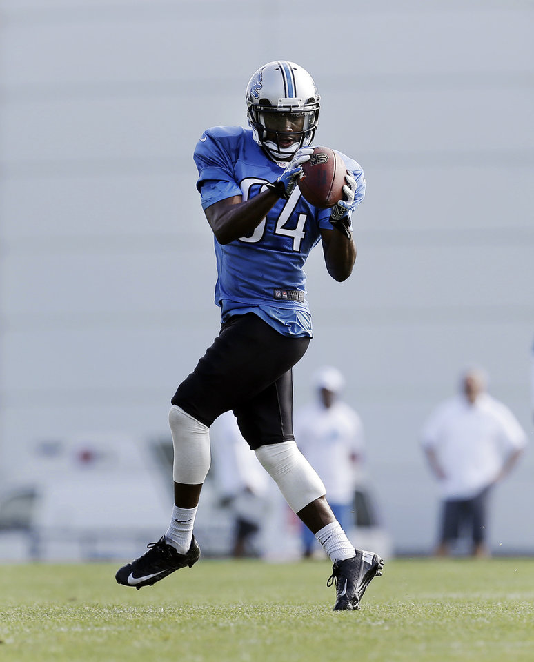 Detroit Lions wide receiver Ryan Broyles (OU) catches a ball at the teams NFL football practice facility in Allen Park, Mich., Thursday, Aug. 1, 2013. (AP Photo/Paul Sancya) ORG XMIT: MIPS102