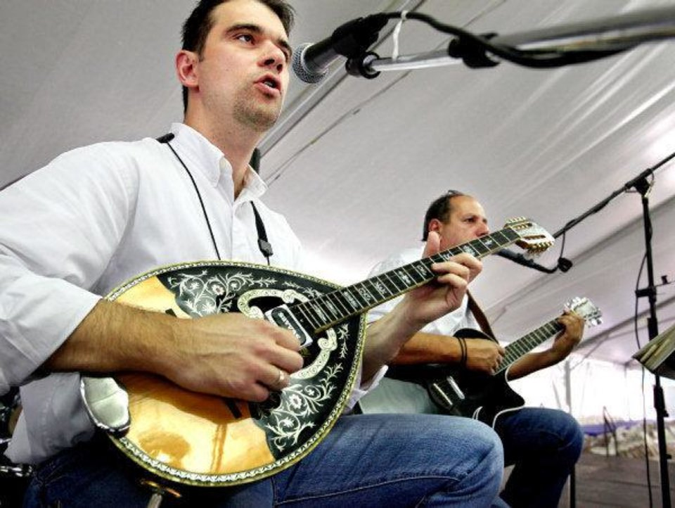 Photo - Yianni plays a bouzouki and Pavlos plays the guitar as they perform Greek music on Friday, Sep. 9, 2011, during the 27th annual Greek Festival at St. George Greek Orthodox Church in far northwest Oklahoma City.  They are members of the band, Tokefi, which will be entertaining audiences throughout the weekend at the festival.  Photo by Jim Beckel, The Oklahoman  ORG XMIT: KOD