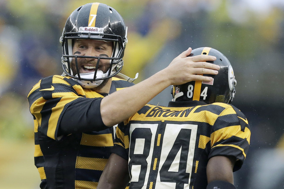 Photo - Pittsburgh Steelers quarterback Ben Roethlisberger (7) celebrates with wide receiver Antonio Brown (84) after the two connected for a touchdown catch in the first half of an NFL football game against the Detroit Lions in Pittsburgh, Sunday, Nov. 17, 2013. (AP Photo/Gene J. Puskar)
