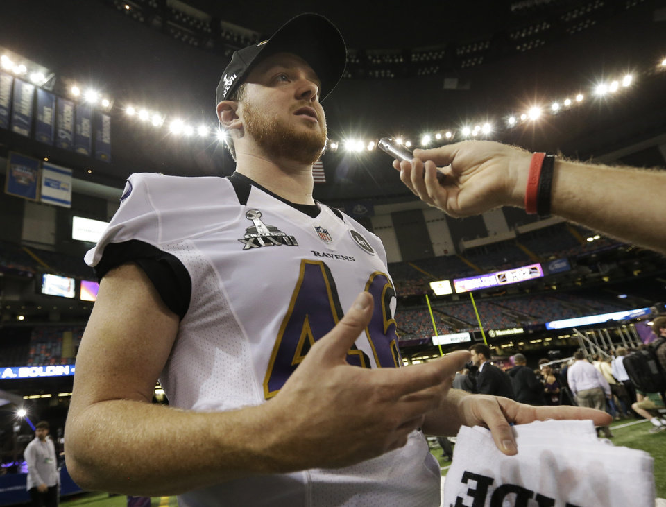 Photo - Baltimore Ravens long snapper Morgan Cox is interviewed during media day for the NFL Super Bowl XLVII football game Tuesday, Jan. 29, 2013, in New Orleans. (AP Photo/Pat Semansky)