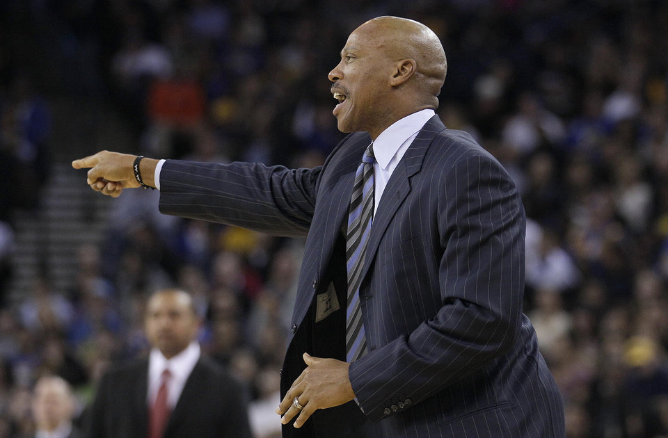 Cleveland Cavaliers head coach Byron Scott points during the second quarter of an NBA basketball game against the Golden State Warriors in Oakland, Calif., Wednesday, Nov. 7, 2012. The Warriors won 106-96. (AP Photo/Jeff Chiu)