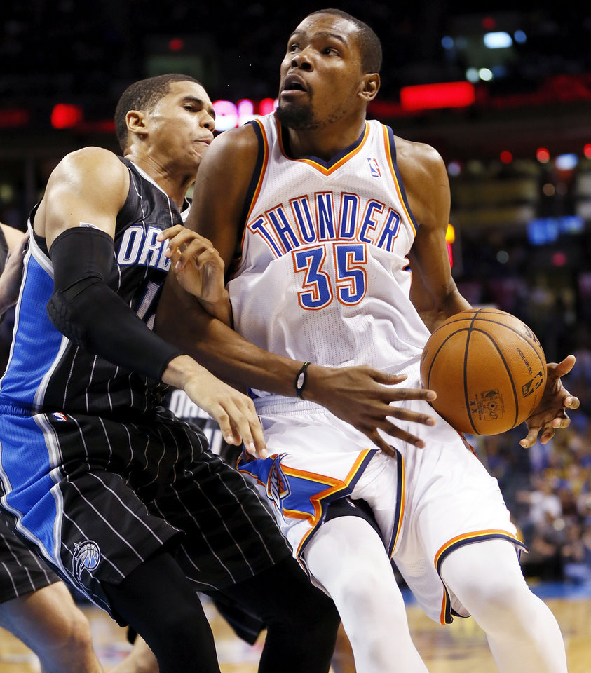 Photo - Orlando's Tobias Harris (12), left, fouls Oklahoma City's Kevin Durant (35) during an NBA basketball game between the Oklahoma City Thunder and the Orlando Magic at Chesapeake Energy Arena in Oklahoma City, Friday, March 15, 2013. Photo by Nate Billings, The Oklahoman