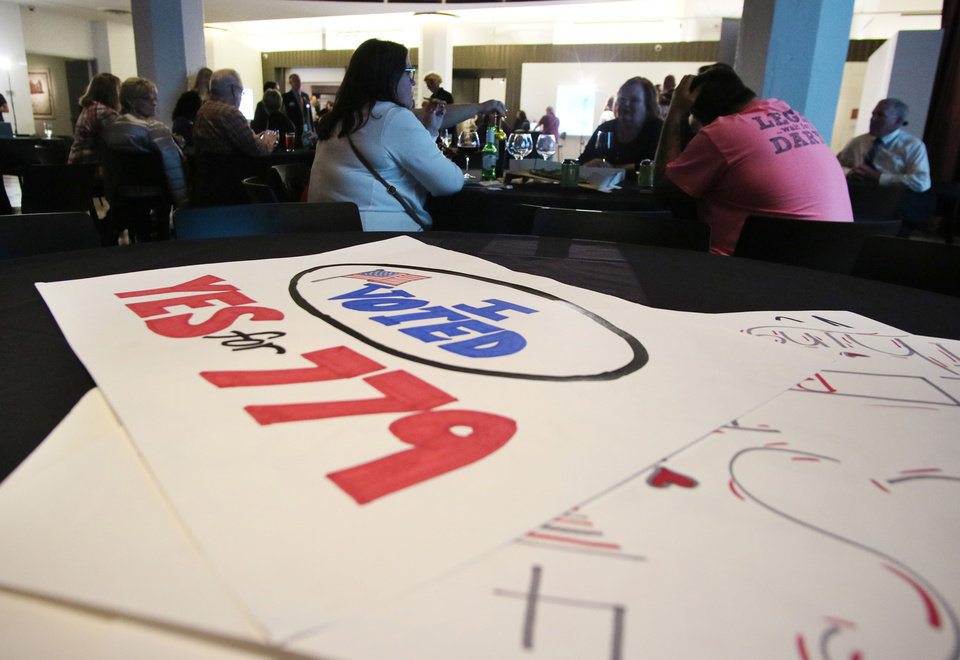 Photo - Signs wait on a table for the start of a watch party for State Question 779 at 21c in Oklahoma City Tuesday, November 8, 2016. Photo by Doug Hoke, The Oklahoman