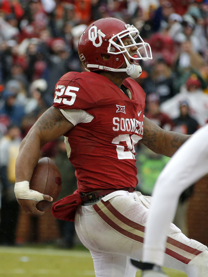 Photo - Oklahoma's Joe Mixon (25) scores a touchdown late in the fourth quarter of the Bedlam college football game between the Oklahoma Sooners (OU) and the Oklahoma State Cowboys (OSU) at Gaylord Family - Oklahoma Memorial Stadium in Norman, Okla., Saturday, Dec. 3, 2016. Oklahoma won 38-20. Photo by Bryan Terry, The Oklahoman