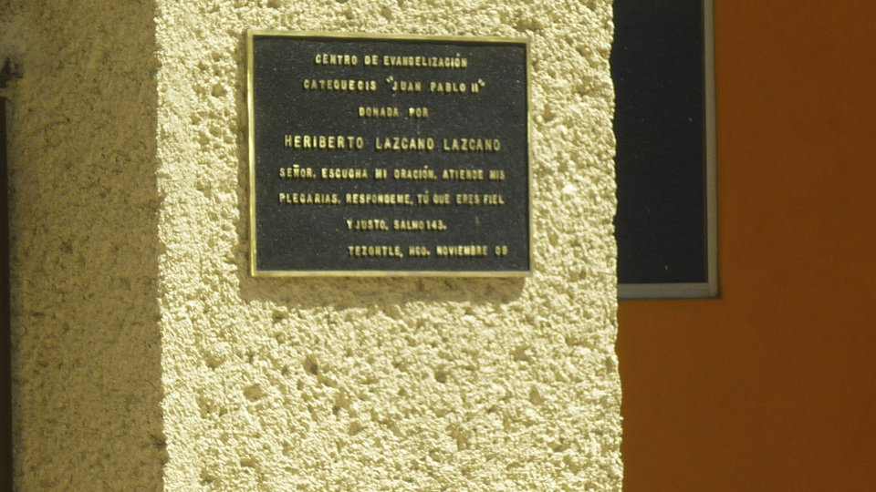 Photo -   FILE - This Oct. 20, 2010 file photo shows a plaque dated Nov. 2009 on the wall of a church in the neighborhood of Tezontle in Pachuca, Mexico. The plaque thanks the major donor who built the church, Heriberto Lazcano Lazcano, alleged leader of the Zetas, reading in Spanish
