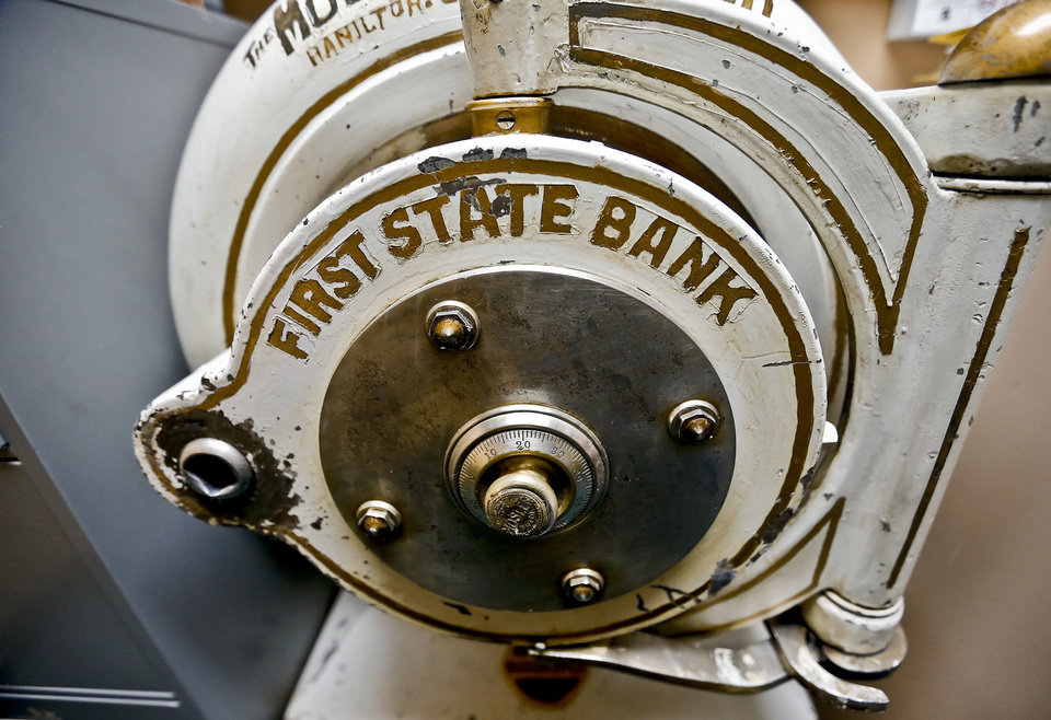 Photo - One of the original safes that was used by First State Bank seen on Friday, Aug. 23, 2013 in Elmore City, Okla. The bank established in 1903 is the smallest bank in the state of Oklahoma with $9.5 million in total assets. The home town bank operates with seven employees, and has about 1000 customers in Elmore City that is home to more than 650 residents.   Photo by Chris Landsberger, The Oklahoman