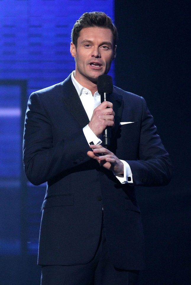 Photo -   Ryan Seacrest presents the award for favorite male artist - pop/rock at the 40th Annual American Music Awards on Sunday, Nov. 18, 2012, in Los Angeles. (Photo by Matt Sayles/Invision/AP)