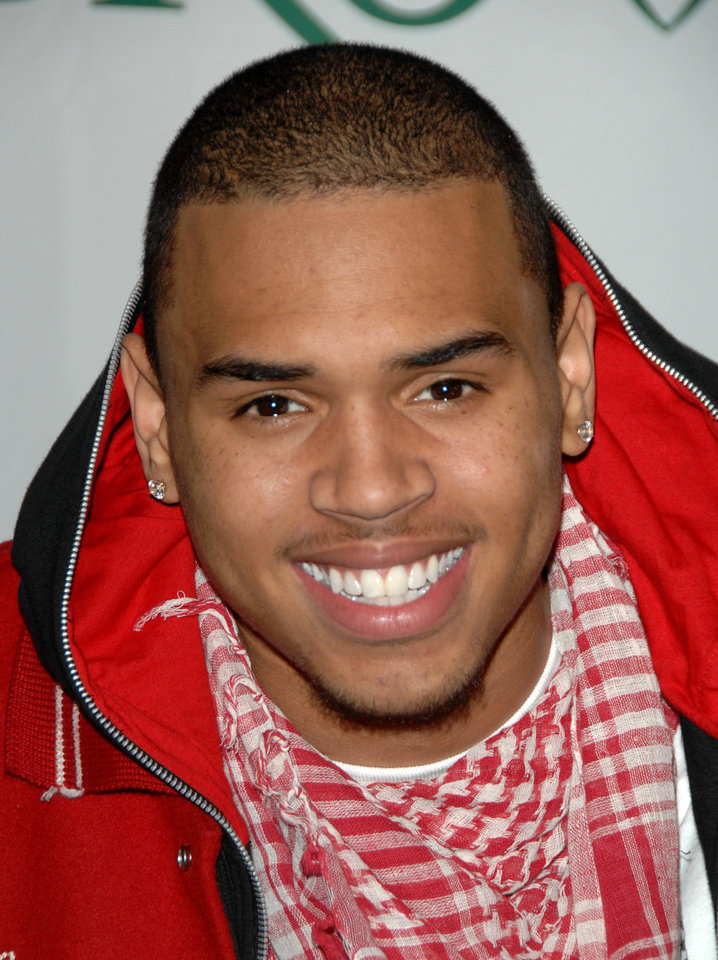 FILE - Singer Chris Brown appears at a news conference to announce his partnership with Ford\'s Sync, a voice activated hands free in car communication and entertainment system, in this Nov. 2, 2007 file photo taken in New York. Authorities are investigating allegations that Grammy-winning singer Chris Brown assaulted a man in a West Hollywood parking lot Sunday Jan. 27, 2013. (AP Photo/Peter Kramer, File)