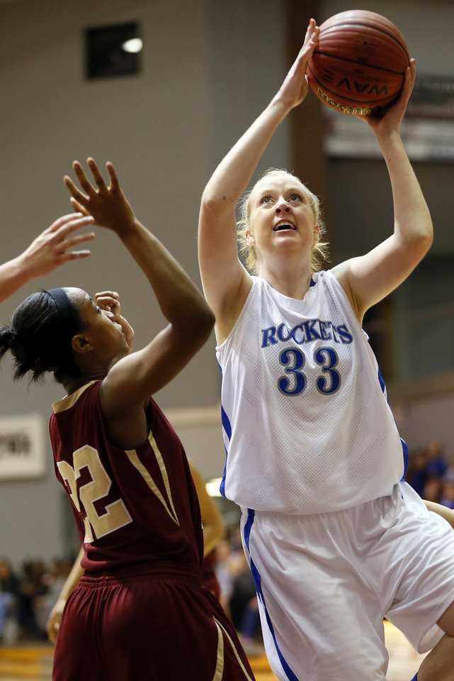 Photo - Mount St. Mary's Brittany Davis (33) shoots against Mackenzie Hudson (22) of Byng during a Class 4A girls high school basketball game in the first round of the state tournament at the Sawyer Center on the campus of Southern Nazarene University in Bethany, Okla., Thursday, March 7, 2013. Photo by Nate Billings, The Oklahoman