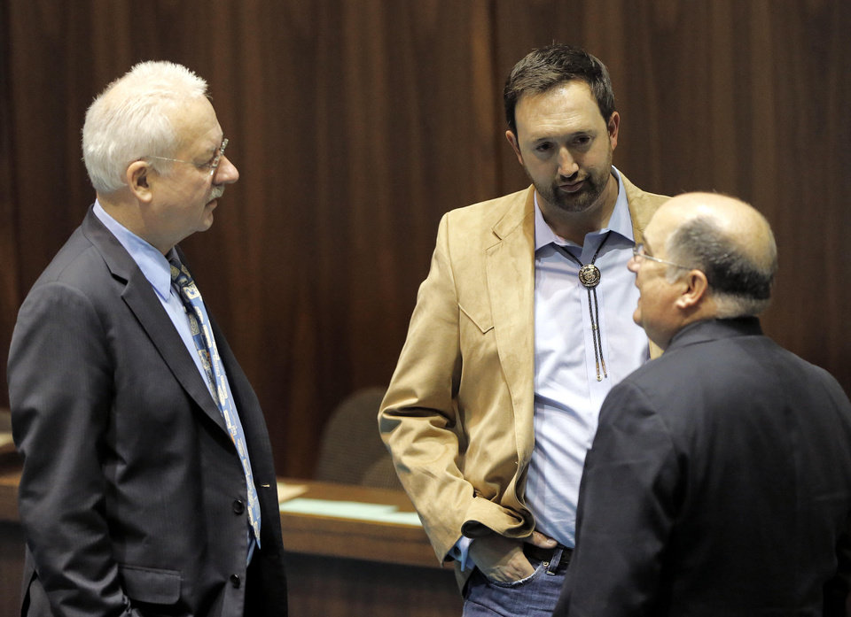 Photo - Arizona State Rep's Adam Kwasman, R-Oro Valley, center, John Kavanaugh, R-Fountain Hills, left, and John Allen, R-Scottsdale, speak during a special session for Medicaid funding on Thursday, June 13, 2013, in Phoenix. (AP Photo/Matt York)