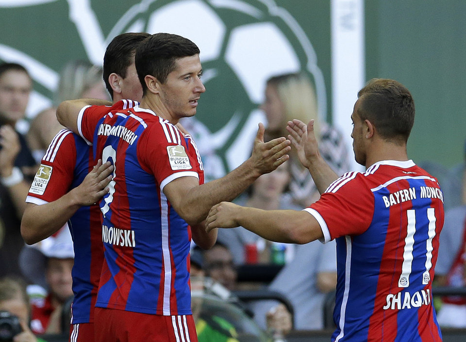 Photo - Bayern Munich's Robert Lewandowski, (9) is greeted by Xherdan Shaqiri, right, after Lewandowski scored a goal against the MLS All-Stars in the first half of the MLS soccer All-Star match, Wednesday, Aug. 6, 2014, in Portland, Ore. (AP Photo/Ted S. Warren)