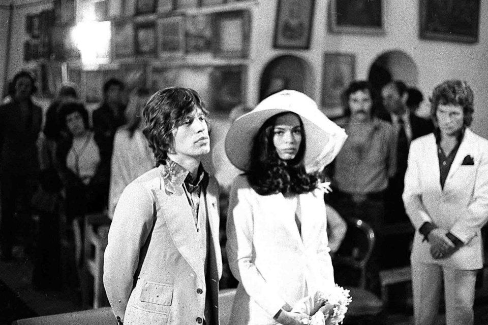 Photo - FILE-   This May 12, 1971 file photo shows Rolling Stones frontman Mick Jagger and his bride, Bianca Perez Morena de Macias, during their wedding in the Sainte-Anne chapel in Saint Tropez, France. Jagger, neither a princess, presidential relative nor movie star, created a pop-culture sensation as a fashion rebel when she married Mick Jagger in a Savile Row-made pantsuit, also in 1971.   (AP Photo/FILE)