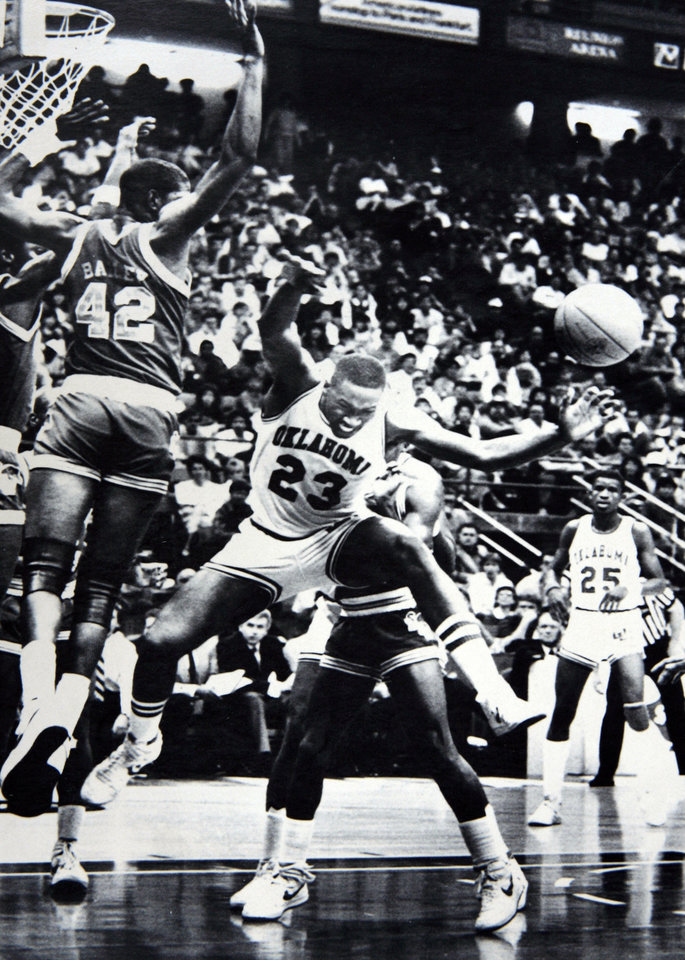 Former OU basketball player Wayman Tisdale. DALLAS, Texas March 23--Wayman Tisdale is fouled by Andre Turner during the second half of Saturday's NCAA Midwest Regional in Dallas. Photo by Doug Hoke 1985. Photo taken 3/23/1985, photo published 3/25/1985 in The Daily Oklahoman. ORG XMIT: KOD