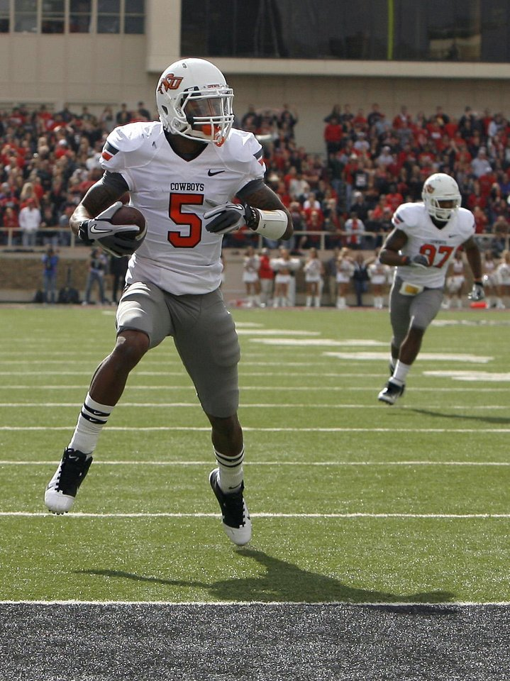 Photo - Oklahoma State Cowboys's Josh Stewart (5) scores a touchdown during a college football game between Texas Tech University (TTU) and Oklahoma State University (OSU) at Jones AT&T Stadium in Lubbock, Texas, Saturday, Nov. 12, 2011.  Photo by Sarah Phipps, The Oklahoman  ORG XMIT: KOD