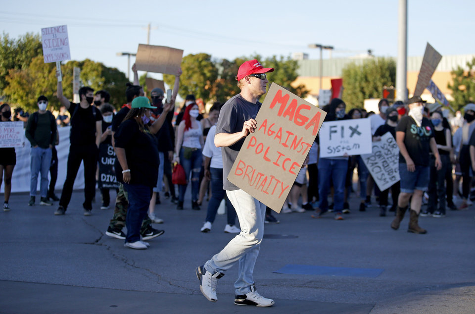 Photo - A protester holds a sign a during a protest near the intersection of 23rd and Classen in Oklahoma City, Saturday, May 30, 2020. The protest was in response to the death of George Floyd. [Sarah Phipps/The Oklahoman]