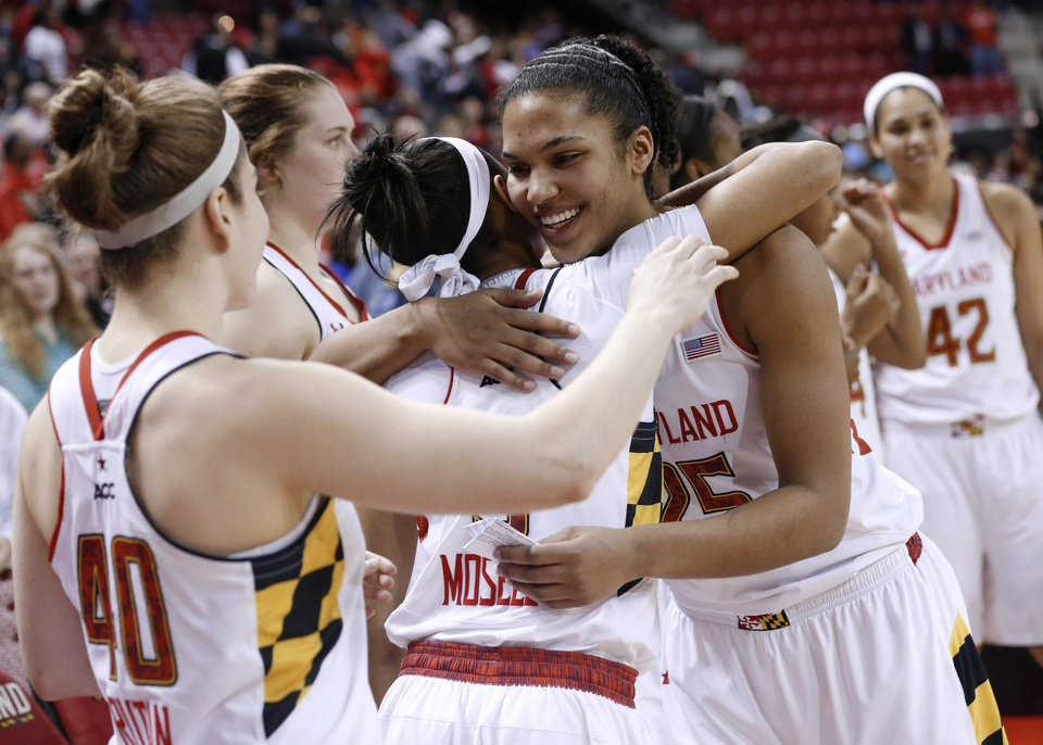 Photo - FILE - In this March 2, 2014 file photo, Maryland forward Alyssa Thomas hugs teammates after a ceremony honoring her after an NCAA college basketball game against Virginia Tech in College Park, Md. Thomas was selected to The Associated Press women's basketball All-America team, released Tuesday, April 1, 2014. (AP Photo/Patrick Semansky, File)
