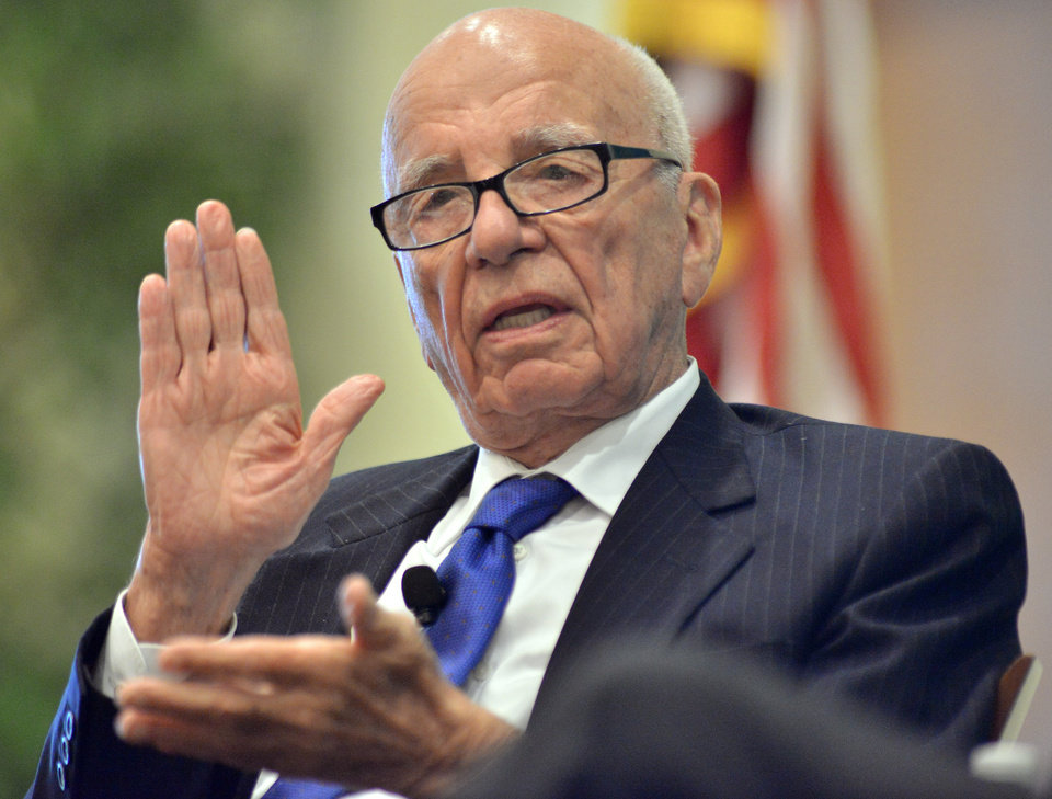 Photo - FILE - In this Aug. 14, 2012 file photo, News Corporation CEO Rupert Murdoch speaks during a forum on The Economics and Politics of Immigration in Boston. Murdoch's Twenty-First Century Fox on Wednesday, July 16, 2014 said Time Warner has rejected an offer it made last month to combine the two media and entertainment giants. (AP Photo/Josh Reynolds, File)