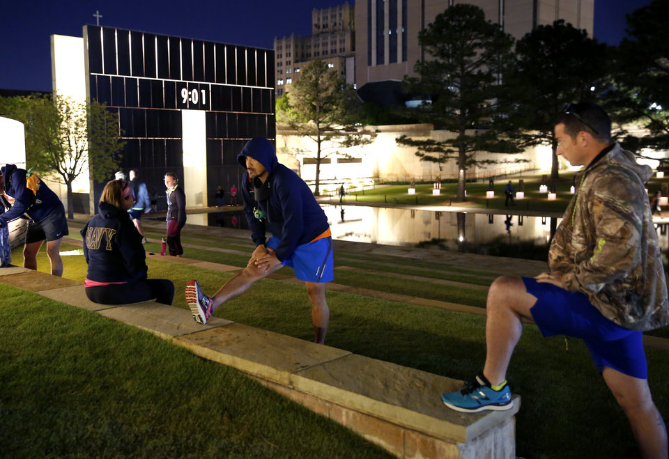 Photo - Runners stretch before the Oklahoma City Memorial Marathon in Oklahoma City, Sunday, April 28, 2019. [Bryan Terry/The Oklahoman]