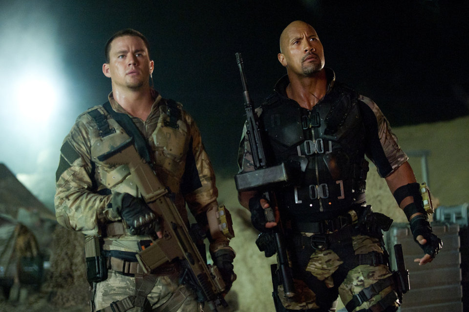 Channing Tatum, left, and Dwayne Johnson in a scene from