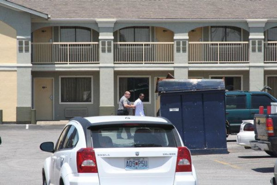 Photo - Keonta Stephan Terrell Prince, 18, being arrested Sunday afternoon at a Super 8 hotel near SW 3 and Meridian Ave. A bystander from Alma, Ark., visiting Oklahoma City for another event, provided the photos.