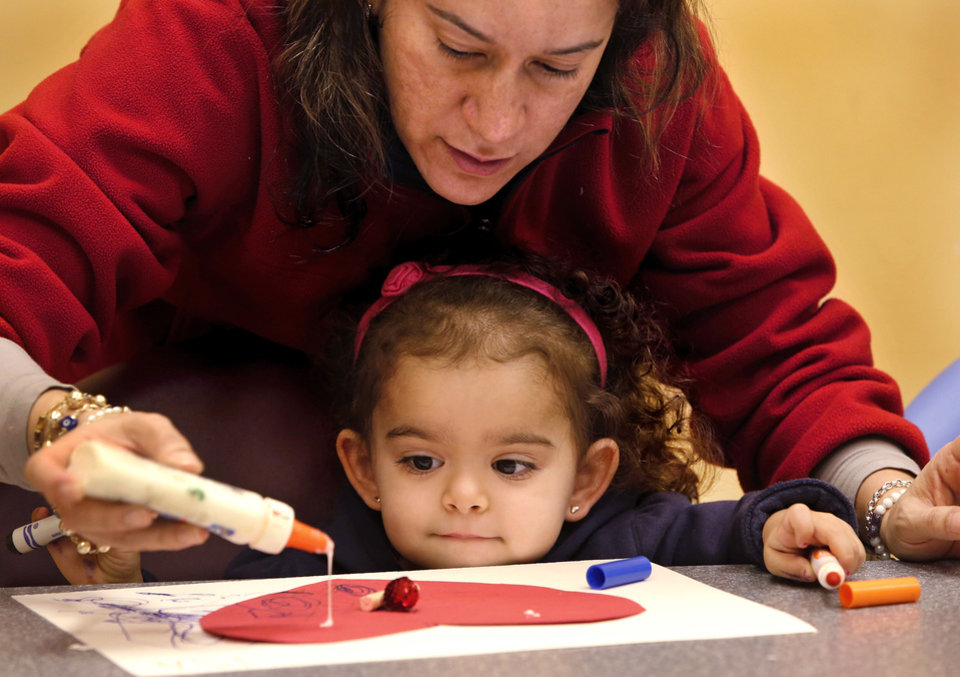 Isabella Bradford, 2, and her mother, Rebecca Bradford, work together on an art creation. The Oklahoma City Museum of Art hosts Tiny Tuesdays for children ages 2 to 5. Photos by Jim Beckel, The Oklahoman