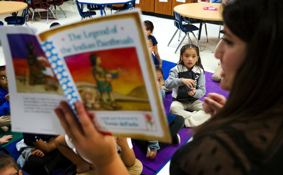 Photo - Heronville Elementary first grader Camila Corrales answers a question during a lesson from her teacher Alicia Strawn about the story of Thanksgiving from the Native American perspective while in class at Heronville Elementary in Oklahoma City, Okla. on Thursday, Nov. 21, 2019. [Chris Landsberger/The Oklahoman]