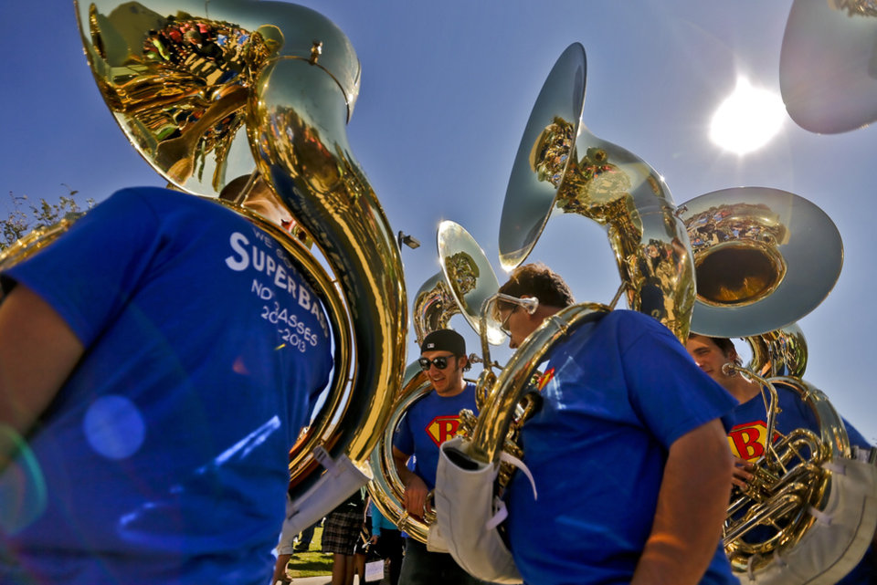 "The tuba section prepares to perform as the ""Band of The Fighting Irish,"" along with the spirit squads and mascot put on a special performance for the patients and employees of The Children's Center on Friday, Oct. 26, 2012, in Bethany, Okla. Photo by Chris Landsberger, The Oklahoman"