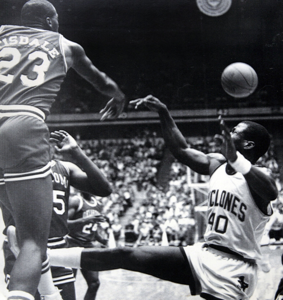 Former OU basketball player Wayman Tisdale. OU's Wayman Tisdale rejects this shot by Iowa State's Ron Harris during the Sooners' 74-68 loss to the Cyclones on Wednesday in the opener of the Big Eight Conference season. Photo taken unknown, Photo published 1/12/1984 in The Daily Oklahoman. ORG XMIT: KOD
