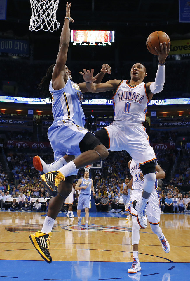 Oklahoma City's Russell Westbrook (0) can't get past Denver's Kenneth Faried (35) during an NBA basketball game between the Oklahoma City Thunder and the Denver Nuggets at Chesapeake Energy Arena in Oklahoma City, Tuesday, March 19, 2013. Denver won 114-104. Photo by Bryan Terry, The Oklahoman