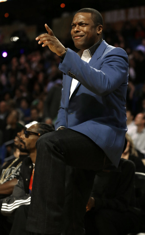 Photo - Actor Chris Tucker dances during the NBA All Star basketball game, Sunday, Feb. 16, 2014, in New Orleans. (AP Photo/Gerald Herbert)