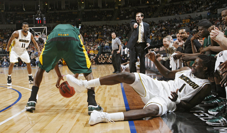 Missouri's DeMarre Carroll (1) falls into the Baylor bench after chasing a loose ball in the Championship game of the Big 12 Men's Basketball Championships between Baylor University and The University of Missouri at the Ford Center on Saturday, March 14, 2009, in Oklahoma City, Okla.