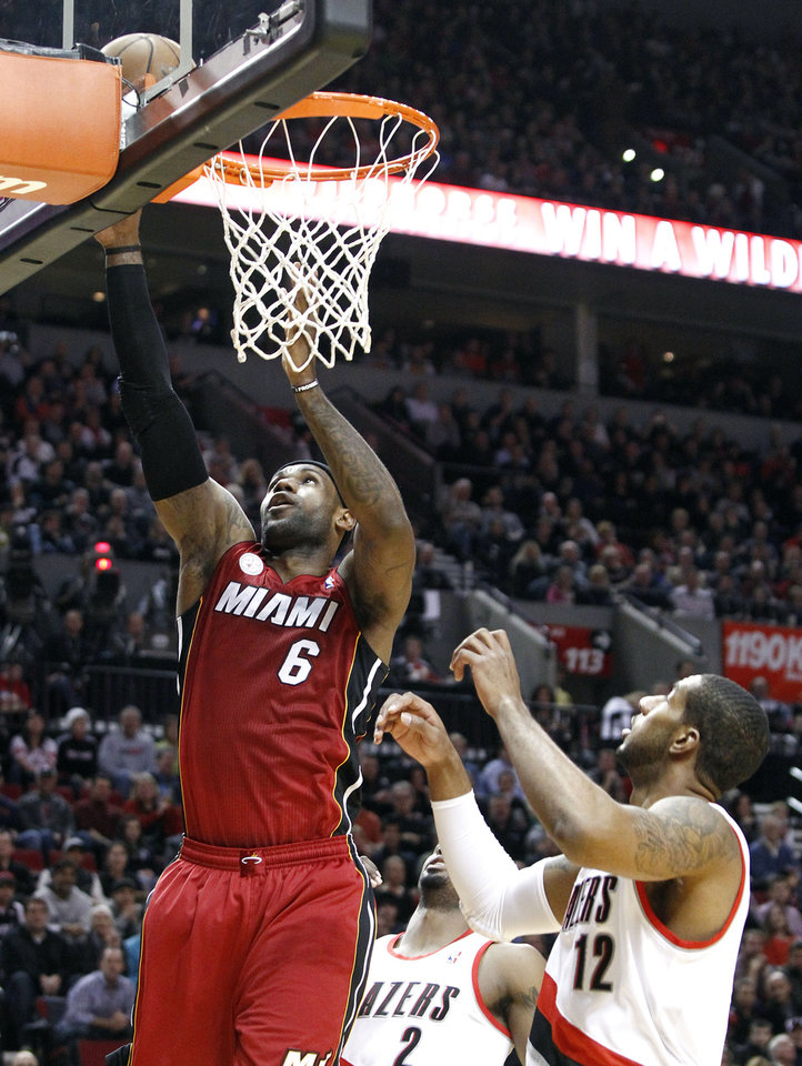 Miami Heat forward LeBron James (6) shoots against Portland Trail Blazers forward LaMarcus Aldridge during the first quarter of an NBA basketball game in Portland, Ore., Thursday, Jan. 10, 2013. (AP Photo/Don Ryan)