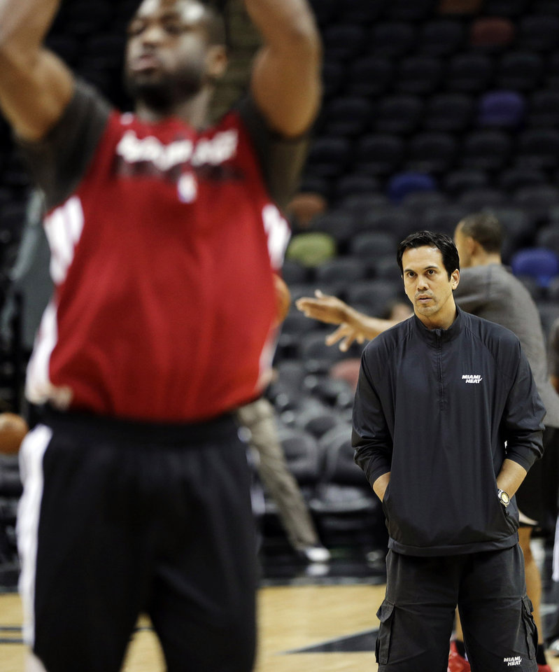 Photo - Miami Heat's Erik Spoelstra, right, watches Dwyane Wade shoot during NBA basketball practice, Saturday, June 15, 2013, in San Antonio. The Heat take on the San Antonio Spurs in Game 5 of the NBA Finals on Sunday, with the best-of-seven games series even at 2-2.  (AP Photo/David J. Phillip)