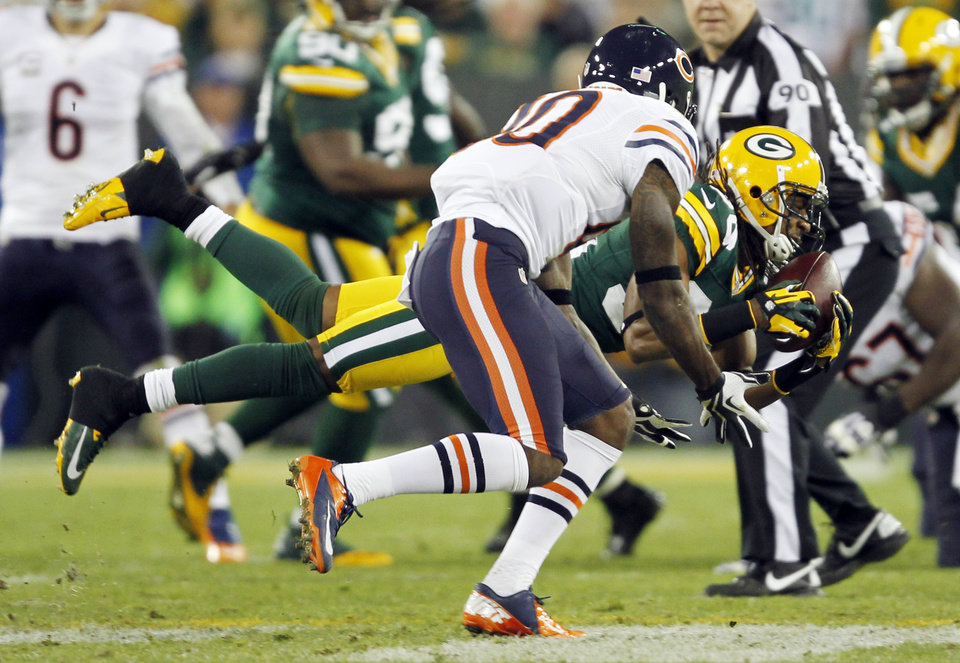 Photo -   Green Bay Packers' Tramon Williams intercepts a pass in front of Chicago Bears' Earl Bennett (80) during the first half of an NFL football game Thursday, Sept. 13, 2012, in Green Bay, Wis. (AP Photo/Mike Roemer)