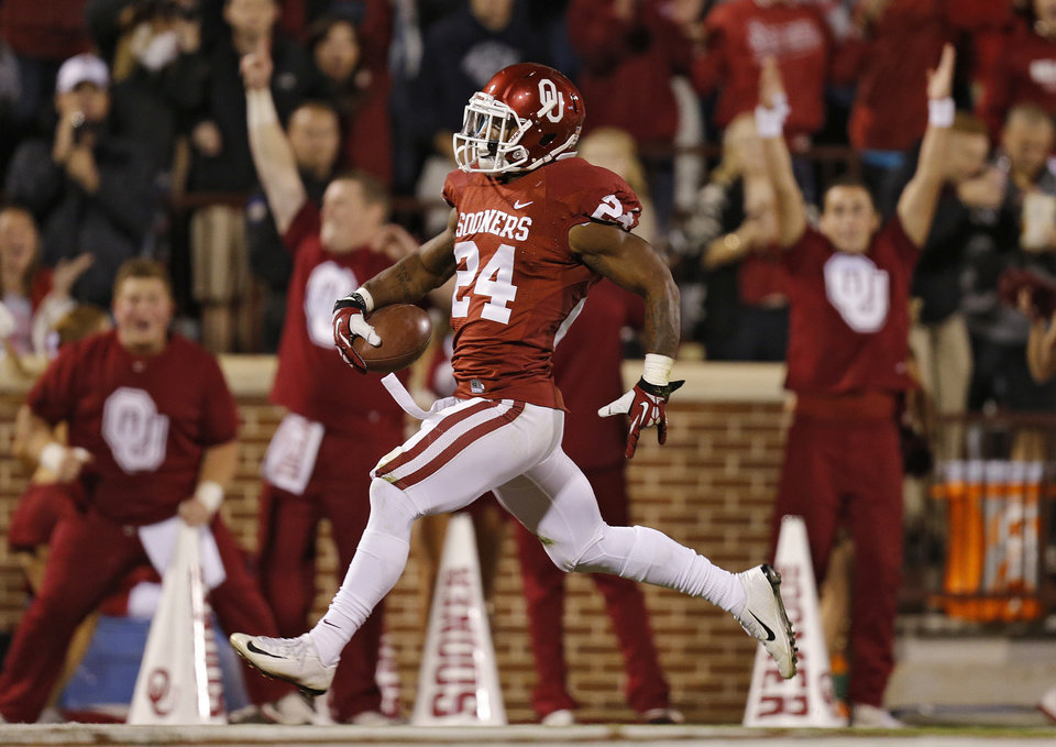 Photo - Oklahoma's Brennan Clay (24) runs into the end zone for a touch down during the college football game between the University of Oklahoma Sooners (OU) and the Texas Christian University Horned Frogs (TCU) at the Gaylord Family-Oklahoma Memorial Stadium on Saturday, Oct. 5, 2013 in Norman, Okla.   Photo by Chris Landsberger, The Oklahoman