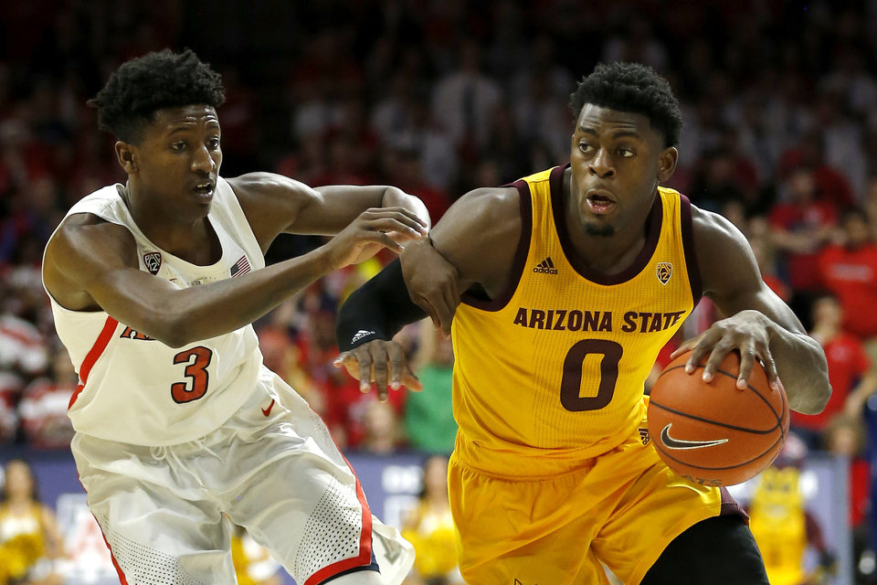 Photo - Arizona State guard Luguentz Dort (0) drives past Arizona guard Dylan Smith in the first half during an NCAA college basketball game, Saturday, March 9, 2019, in Tucson, Ariz. (AP Photo/Rick Scuteri)